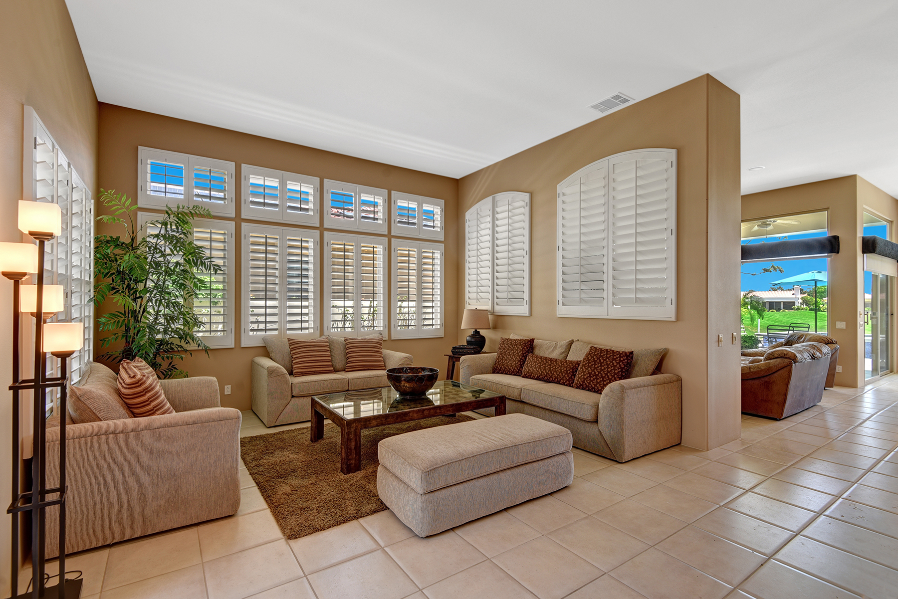 A88855E2-FE9A-2095-E21AEF0DFDCC9832-LIVING ROOM ANGLED TO FAMILY ROOM AND VIEW RS.jpg